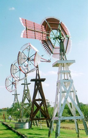 Antique wood windmills standing at American Wind Power Center showing the different variety of designs. bsg